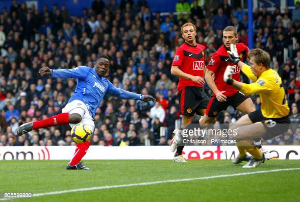 Portsmouth's Aruna Dindane has a shot on goal saved by Manchester United's Tomasz Kuszczak