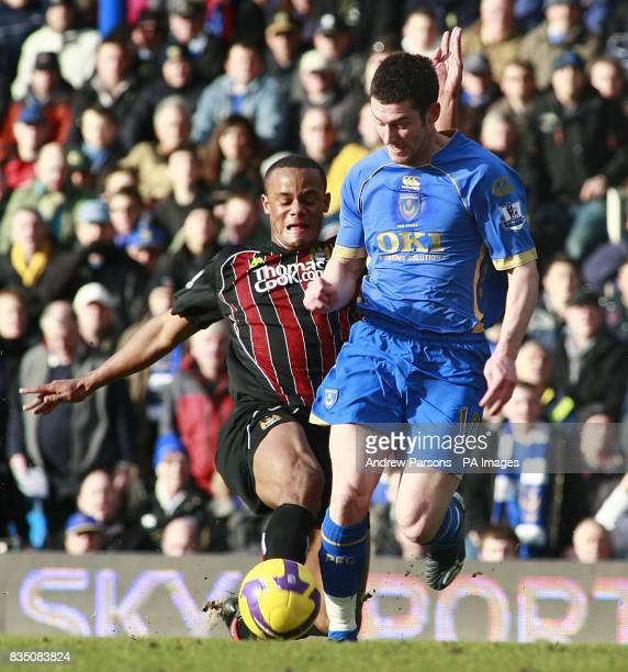 Portsmouth's David Nugent and Manchester City's Vincent Kompany battle for the ball