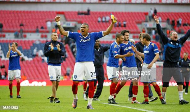 Portsmouth's Ghanaian player Kevin Prince Boateng leads the celebrations after the FA Cup semifinal football match between Tottenham Hotspur and...