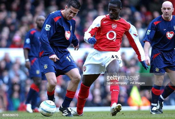 Portsmouth's Giannis Skopelitis battles for the ball with Arsenal's Quincy OwusuAbeyie