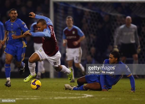 Portsmouth's Glen Johnson fouls Aston Villa's Gabriel Agbonlahor