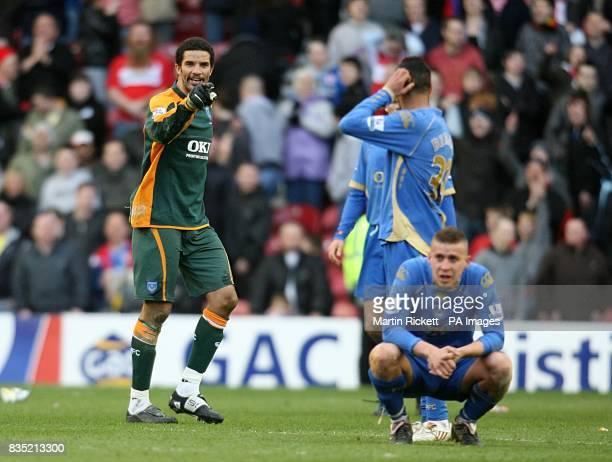Portsmouth's goalkeeper David James points the finger at his team mates after Middlesbrough's last minute equaliser