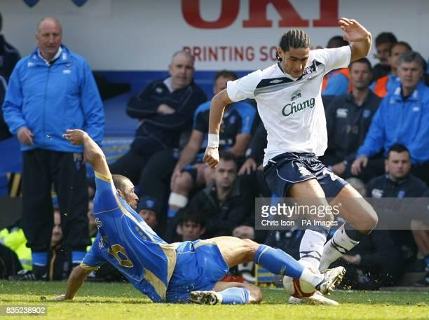 Portsmouth's Hayden Mullins challenges Everton's Marouane Fellaini