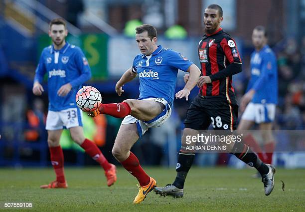 Portsmouth's Irish midfielder Michael Doyle controls the ball during the English FA Cup fourth round football match between Portsmouth and...