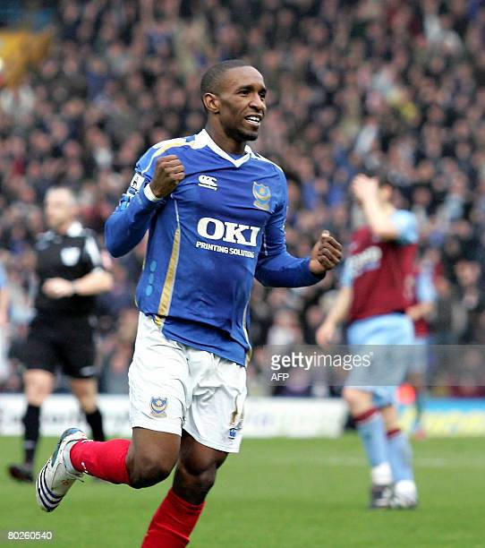 Portsmouth's Jermain Defoe of celebrates scoring the second goal after his saved shot is deflected into the goal by Aston Villa's Nigel ReoCoker...