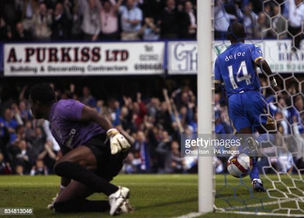 Portsmouth's Jermain Defoe scores the their second goal Also in picture Guimaraes' Correa Junior Nilson