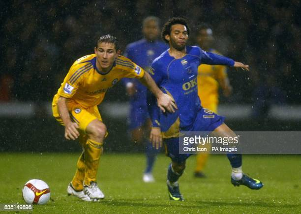 Portsmouth's Jermaine Pennant and Chelsea's Frank Lampard battle for the ball