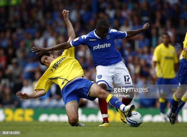 Portsmouth's John Utaka in action with Cardiff City's Peter Whittingham during the npower Championship match at Fratton Park Portsmouth