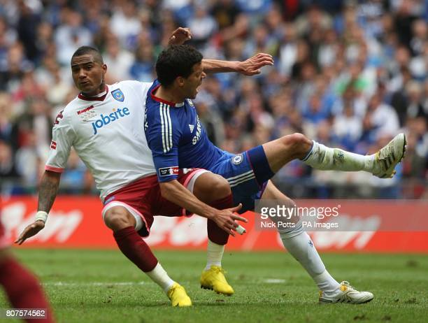 Portsmouth's KevinPrince Boateng fouls Chelsea's Michael Ballack for the ball