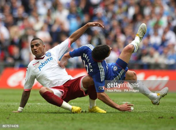 Portsmouth's KevinPrince Boateng fouls Chelsea's Michael Ballack
