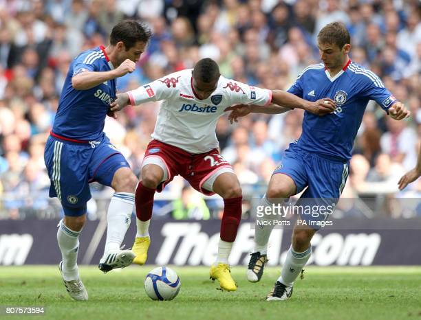 Portsmouth's KevinPrince Boateng is challenged by Chelsea's Frank Lampard and Branislav Ivanovic for the ball