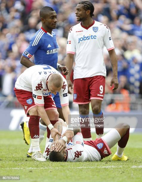Portsmouth's KevinPrince Boateng is consoled by team mate Jamie O'Hara after his penalty shot was saved by Chelsea goalkeeper Petr Cech