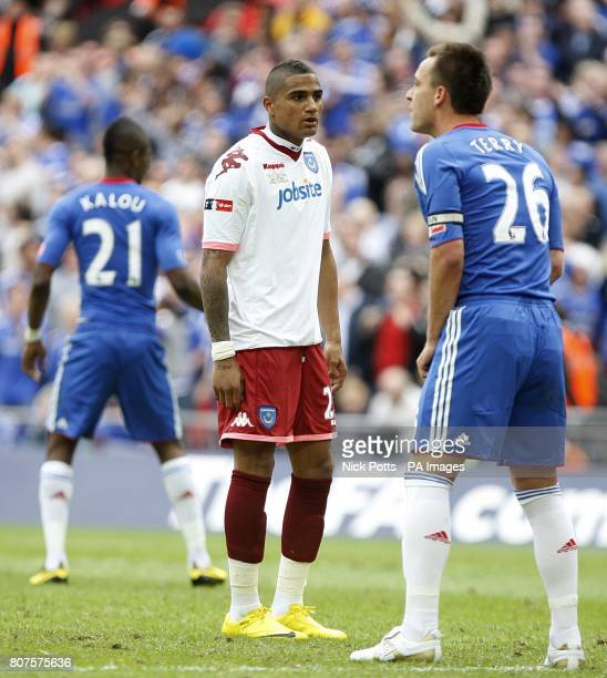 Portsmouth's KevinPrince Boateng stands dejected after having his penalty shot saved by Chelsea goalkeeper Petr Cech