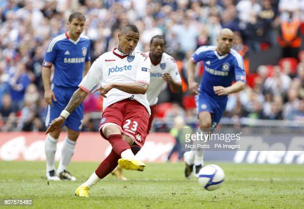 Portsmouth's KevinPrince Boateng takes a penalty shot which is saved by Chelsea goalkeeper Petr Cech