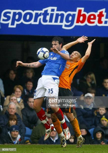 Portsmouth's Marc Wilson and Hull City's Craig Fagan in action