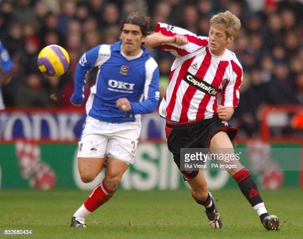 Portsmouth's Miguel Pedro Mendes is challenged by Sheffield United's Jonathan Stead as they battle for the ball