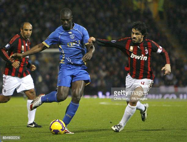 Portsmouth's Papa Bouba Diop and AC Milan's Gennaro Gattuso in action