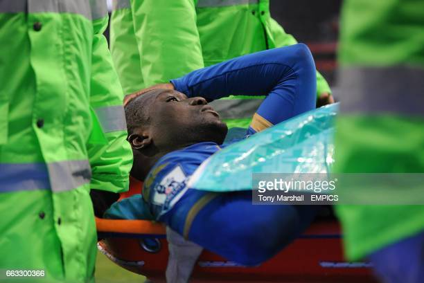 Portsmouth's Papa Bouba Diop is carried off the pitch on a stretcher
