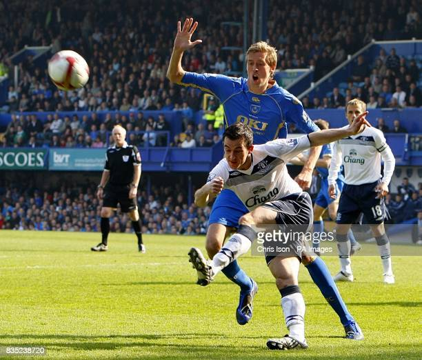 Portsmouth's Peter Crouch and Everton's Leighton Baines in action