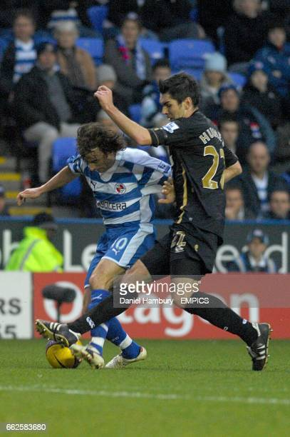 Portsmouth's Richard Hughes and Reading's Stephen Hunt battle for the ball