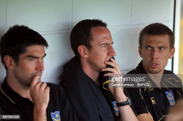 Portsmouth's Richard Hughes Andrew O'Brien and Gary O'Neil in the dugout during the match