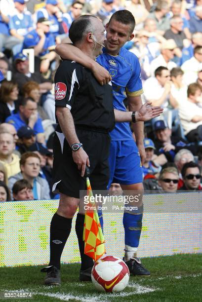 Portsmouth's Sean Davis jokes with the linesman on the touchline