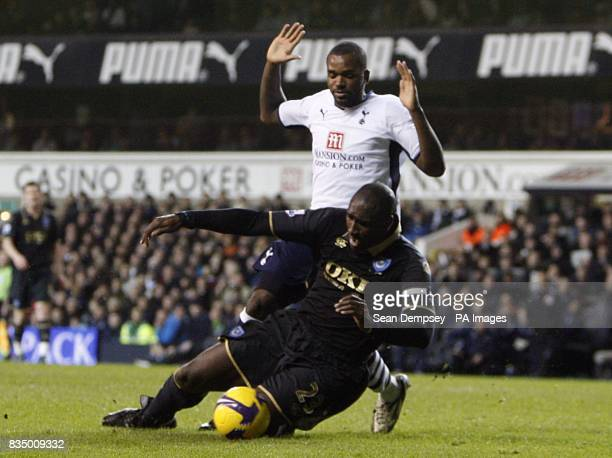 Portsmouth's Sol Campbell and Tottenham Hotspur's Darren Bent battle for the ball