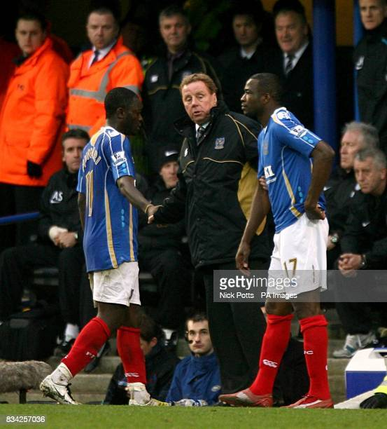 Portsmouth's Sulley Muntari walks by his manager Harry Redknapp after being sent off by referee Chris Foy