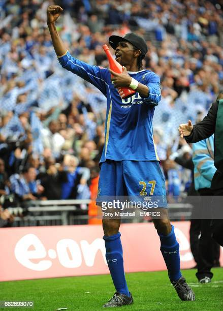 Portsmouth's wining goalscorer and man of the match Nwankwo Kanu celebrates after Portsmouth win the FA Cup