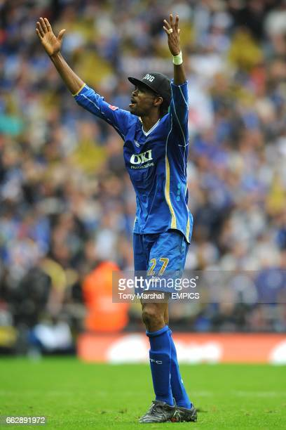 Portsmouth's wining goalscorer and man of the match Nwankwo Kanu celebrates after the final whistle