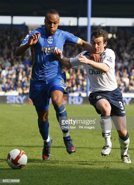 Portsmouth's Younes Kaboul and Everton's Leighton Baines battle for the ball