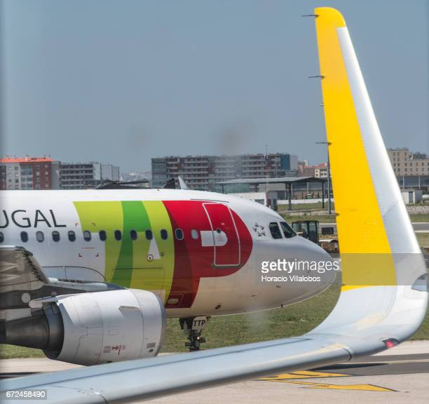 Portugal aircraft taxies by a Vueling airplane in Terminal 1 of Humberto Delgado Airport on April 19 2017 in Lisbon Portugal The airport is the main...