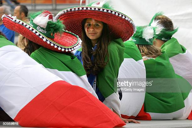 An Italian supporter wears her national flag 22 June 2004 near Henriques stadium in Guimaraes before the beginning of the Euro 2004 group C football...