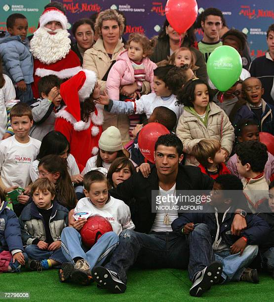 Portugal and Manchester United's football player Cristiano Ronaldo poses with a group of children at Obidos 70 km north of Lisbon 11 December 2007...