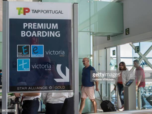 Portugal arriving passengers walk behind the Premiun Boarding sign in departure area of Terminal 1 of Barcelona El Prat Airport on September 10 2017...