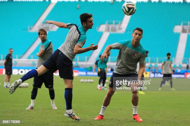 Portugal captain Cristiano Ronaldo in action with Helder Postiga and Fabio Coentrao during training session ahead of Germany game in Salvador...