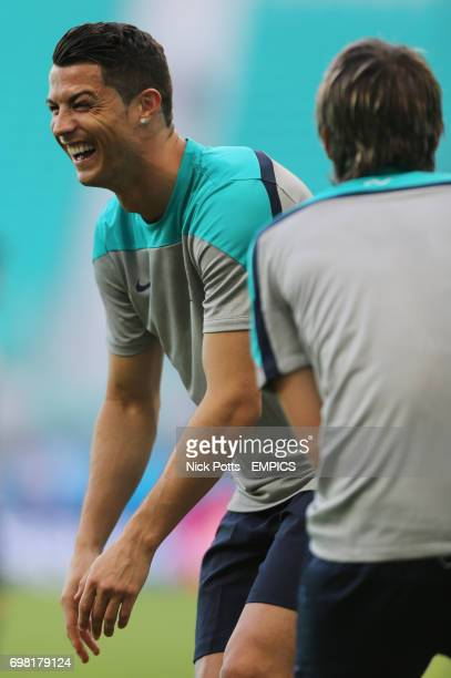 Portugal captain Cristiano Ronaldo shares a joke with teammate Fabio Coentrao during training session ahead of Germany game in Salvador