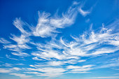 Portugal, Cirrus clouds in blue sky
