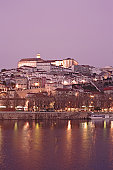Portugal, Coimbra, view of Coimbra and Mondego river at dusk