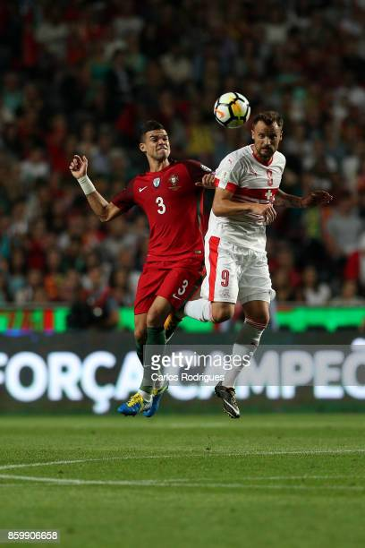 Portugal defender Pepe vies with Switzerland forward Haris Seferovic for the ball possession during the match between Portugal and Switzerland for...