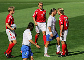 Denmark's midfielder Christian Poulsen argue with Italy's forward Francesco Totti 14 June 2004 at Henriques stadium in Guimaraes for their Euro 2004...