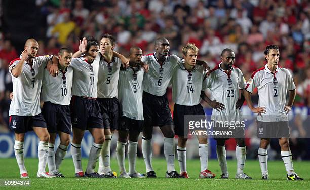 England captain David Beckham and his teammates salute fans after losing against Portugal 24 June 2004 during their European Nations Championship...