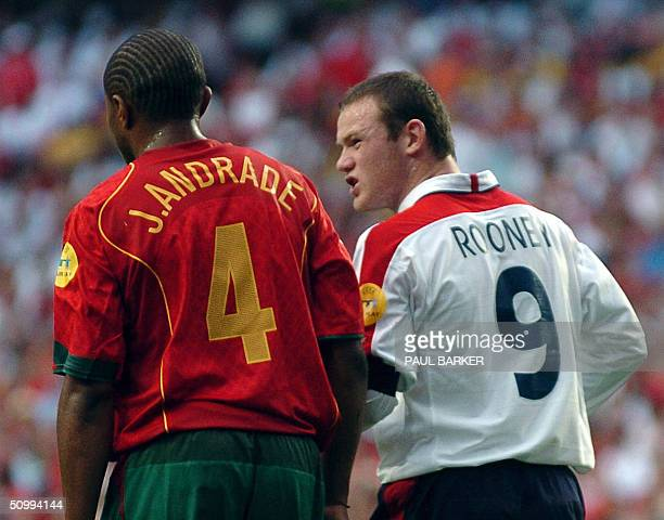 England forward Wayne Rooney and Portugal's defender Jorge Andrade leave the field before the prolongations 24 June 2004 during their European...