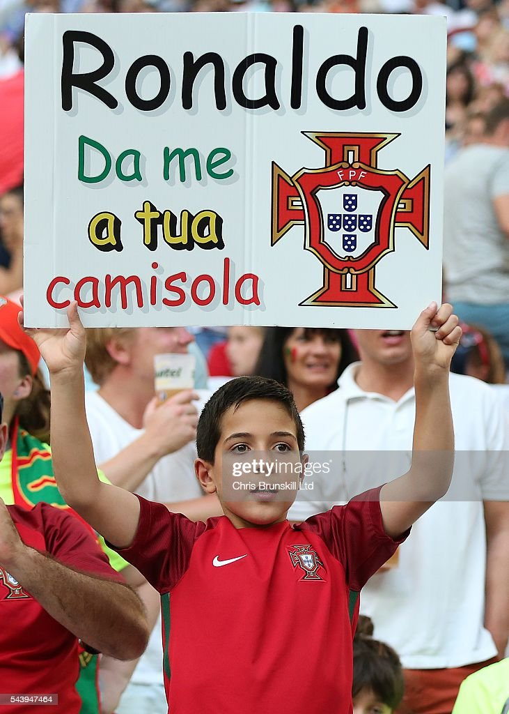 A Portugal fan holds up a Cristiano Ronaldo banner during the UEFA Euro 2016 Quarter Final match between Poland and Portugal at Stade Velodrome on June 30, 2016 in Marseille, France.