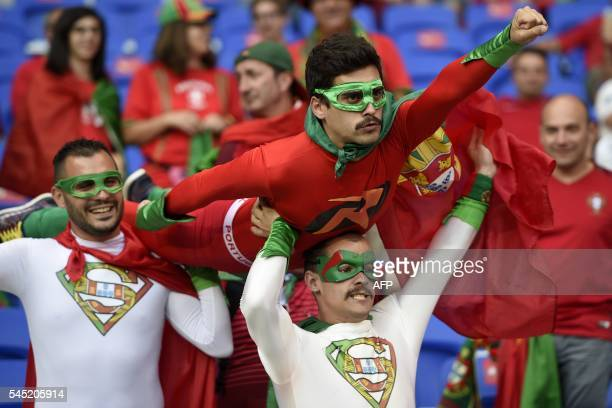 TOPSHOT Portugal fans wait for the start of the Euro 2016 semifinal football match between Portugal and Wales at the Parc Olympique Lyonnais stadium...