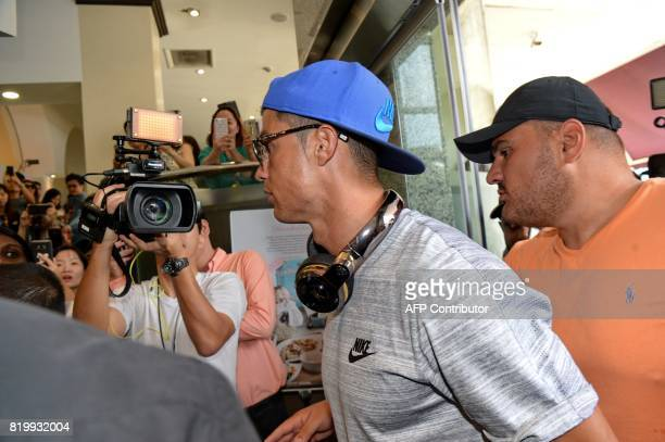 Portugal football player Cristiano Ronaldo arrives at Thomson Medical Hospital to visit the daughter of Singaporean billionaire Peter Lim who just...