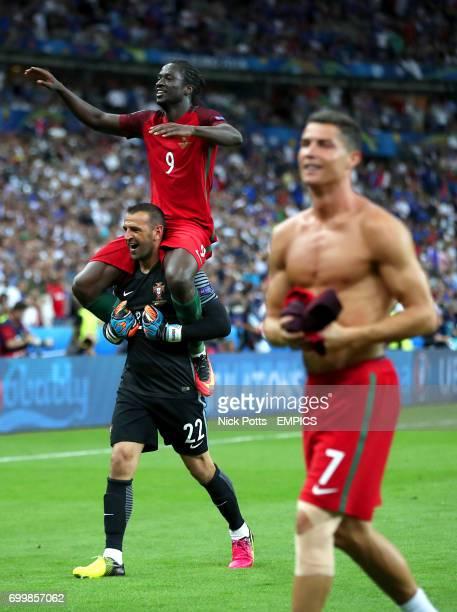 Portugal goalkeeper Eduardo Eder and Portugal's Cristiano Ronaldo celebrate on the pitch after winning the UEFA Euro 2016 final