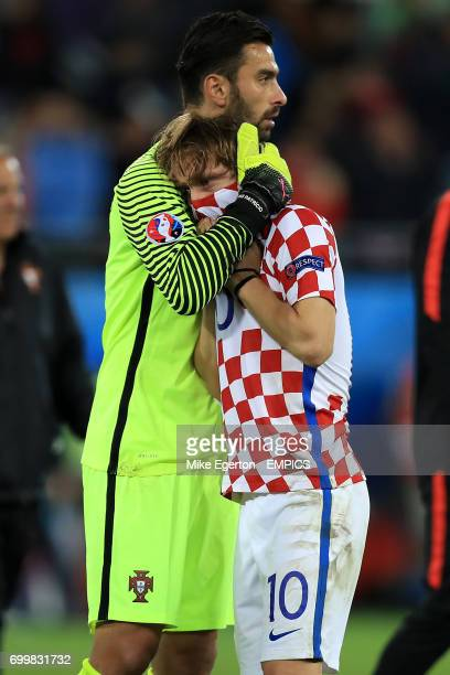 Portugal goalkeeper Rui Patricio consoles Croatia's Luka Modric after the final whistle
