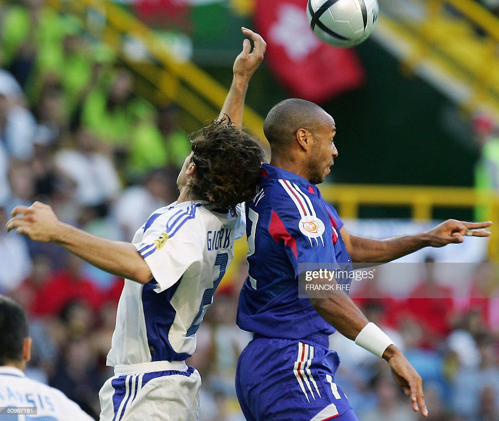 Greece's defender Georgios Seitaridis and French forward Thierry Henry go for a header 25 June 2004 at Estadio Jose De Alvalade in Lisbon during the...
