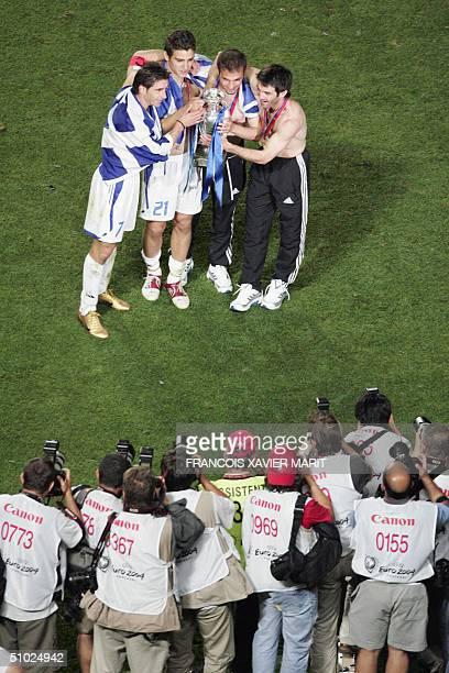 Greece's midfielder Theodoros Zagorakis Konstantinos Katsouranis Angelis Basinas and Georgios Karagounis pose for photographers 04 July 2004 at...